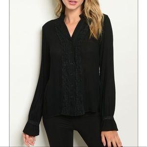 Black Long sleeve V-neck crochet trim tunic top.
